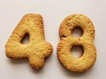 ciastka tworzy liczbę czterdzieści osiem i białego tło zdjęcie stock