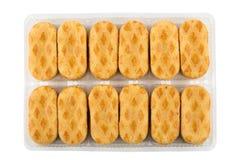 Ciastka w plastikowym pudełku odizolowywającym na białym tle Obrazy Royalty Free