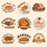 Ciasto emblematy Ustawiający ilustracji