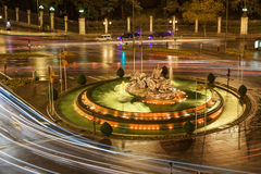 Cibeles fountain in Madrid, Spain. Aerial view of Cibeles fountain rounded of traffic lights in Madrid at night, Spain Royalty Free Stock Photography