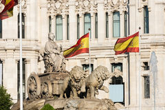Cibeles Fountain in Madrid and Spanish flags Royalty Free Stock Image
