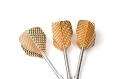 Cible trois jouant des dards, clavette d'or de couleur de petit morceau,   Photographie stock