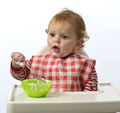 Cibo del bambino in giovane età Fotografie Stock Libere da Diritti