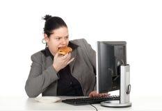 Cibo della donna di affari del grasso della torta Immagini Stock Libere da Diritti