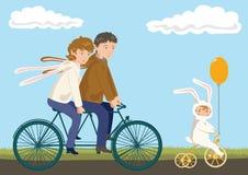 Ciclagem da família: Pai, matriz e criança Fotografia de Stock