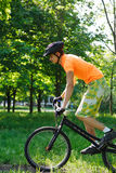 Ciclist. The young cyclist in sportswear outdoors Royalty Free Stock Photos