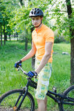 Ciclist. The young cyclist in sportswear outdoors Stock Photography