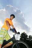Ciclist. The young cyclist in sportswear outdoors Stock Images
