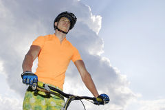 Ciclist. The young cyclist in sportswear outdoors Stock Image