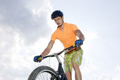 Ciclist. The young cyclist in sportswear outdoors Royalty Free Stock Images