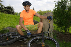 Ciclist. The young cyclist in sportswear outdoors Stock Photos