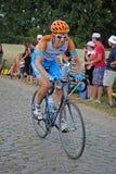 Ciclista con il fronte del painfull Fotografia Stock
