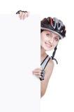 Ciclista de la muchacha con una muestra en blanco Imagenes de archivo