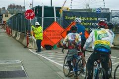 Ciclista e construção de estradas Imagem de Stock