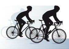 Ciclistas mostrados em silhueta Fotos de Stock