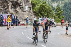Ciclistas que escalam Alpe d'Huez Imagem de Stock Royalty Free