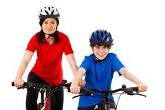 Ciclisti isolati su priorità bassa bianca Fotografia Stock