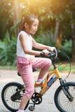 Ciclo asiático del niño al aire libre foto de archivo libre de regalías