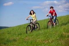 Ciclo de la muchacha y del muchacho Imágenes de archivo libres de regalías