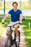 Ciclo en parque Imagenes de archivo