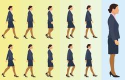 Ciclo que camina de la mujer de negocios Fotografía de archivo libre de regalías
