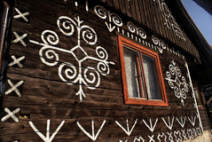 Cicmany. Painted facade of traditional wooden house in Slovakia in famous village of Cicmany Stock Photo