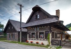 Two houses in Cicmany in SLovakia. Cicmany, Slovakia - august 02, 2015: Old wooden houses in Slovakia village Cicmany, traditional painted with white paint Royalty Free Stock Photos