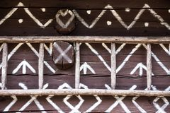 Detail of decorations in Cicmany. Cicmany, Slovakia - august 02, 2015: Old wooden houses in Slovakia village Cicmany, traditional painted with white paint Stock Photos