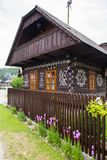 Cicmany in SLovakia. Decorative house in Cicmany. Cicmany, Slovakia - august 02, 2015: Old wooden houses in Slovakia village Cicmany, traditional painted with Stock Images