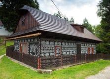 Cicmany, SLovakia. old decorative houses. Cicmany, Slovakia - august 02, 2015: Old wooden houses in Slovakia village Cicmany, traditional painted with white Royalty Free Stock Photo
