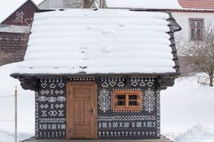 Cicmany, Slovakia. Old wooden houses in Slovakia village Cicmany in winter. The ornaments from Cicmany, and the Slovak folk patter Royalty Free Stock Photos