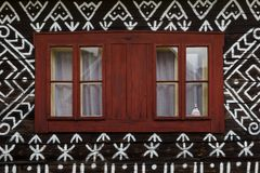 Cicmany village in Zilina region. Windows of a traditional log cabin in Zilina region, Slovakia royalty free stock photo
