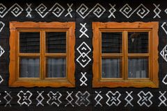 Cicmany village in Zilina region. Windows of a traditional log cabin in Zilina region, Slovakia stock images