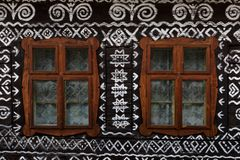 Cicmany village in Zilina region. Windows of a traditional log cabin in Zilina region, Slovakia royalty free stock images