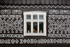 Cicmany village in Zilina region. Windows of a traditional log cabin in Zilina region, Slovakia royalty free stock image