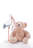 Cicogna con il bambino e un orso di orsacchiotto. Fotografie Stock