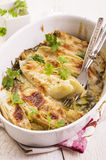 Cicoria al forno con formaggio Immagine Stock