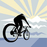 Cicylist racing up the road Royalty Free Stock Images