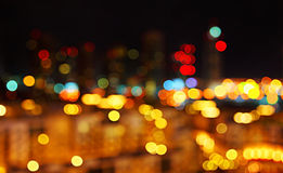 A cidade abstrata ilumina o fundo Imagem de Stock