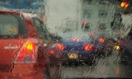Cidade chuvosa. Imagens de Stock