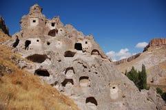 Cidade da caverna de Ortahisar em Cappadocia - ajardine, Turquia Fotografia de Stock