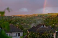 Cidade do campo com arco-íris Fotos de Stock Royalty Free