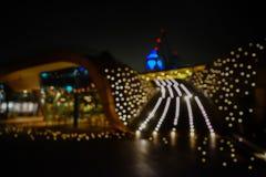 A cidade ilumina o fundo borrado bokeh Fotos de Stock Royalty Free