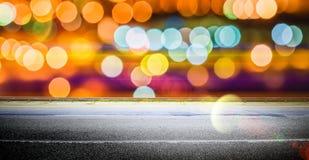A cidade ilumina o fundo da noite da estrada Foto de Stock Royalty Free