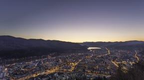 Cidade no por do sol Foto de Stock Royalty Free