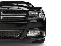 A cidade preta luxuosa moderna ostenta o tiro automobilístico do close up da vista dianteira Imagem de Stock