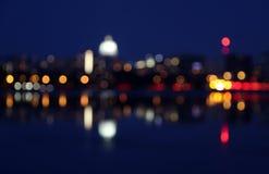 A cidade registrada sumário da noite ilumina o fundo imagem de stock