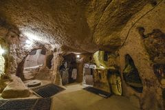 A cidade subterrânea de Derinkuyu é uma cidade antiga da caverna do multi-nível em Cappadocia, Turquia foto de stock royalty free