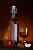 Cider bottle and glass with apple Royalty Free Stock Image