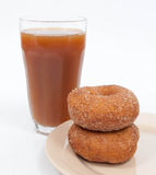 Cider and Donuts. Glass of apple cider with two sugar donuts stock photo